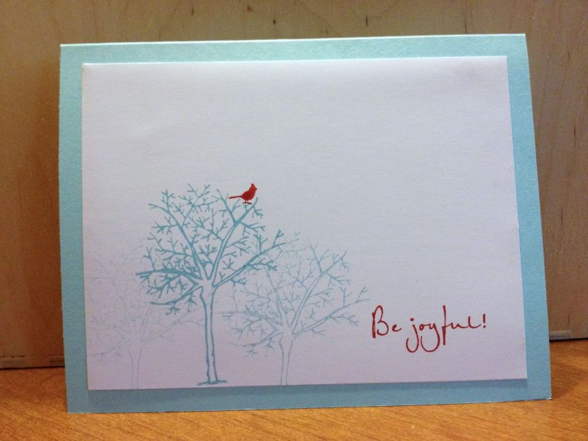winter tree with small cardinal